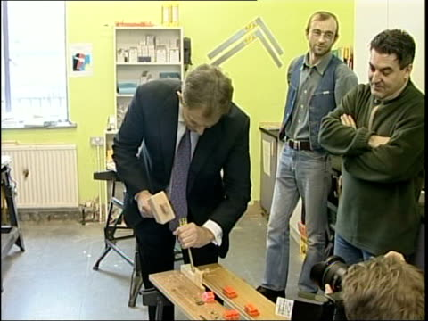 pm tony blair visit to homeless community centre england london east london aspire community enterprise ltd gvs tony blair mp into workshop chatting... - chisel stock videos and b-roll footage
