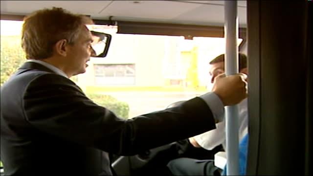 tony blair visit to regenatec biofuel company blair handshake with regenatec employee / blair boarding biofuelrun bus blair standing on bus chatting... - crucifers stock videos & royalty-free footage