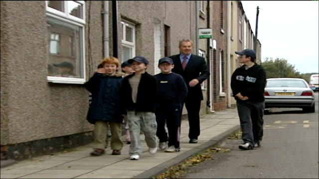 tony blair visiting school and opening play area; england: county durham: sedgefield: ext general views of tony blair mp towards and past with group... - county durham england stock videos & royalty-free footage