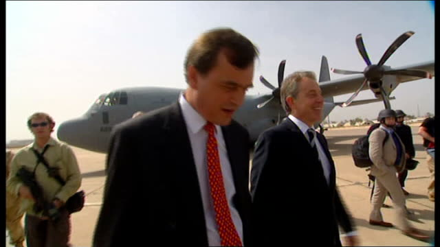 Tony Blair visits British troops Baghdad EXT Tony Blair MP disembarking from military plane on arrival in Baghdad and greeted by British Ambassador...