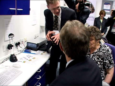 tony blair visits osteoporosis unit; blair sitting at computer as osteoporosis is explained to him by consultant sot - osteoporosis stock videos & royalty-free footage