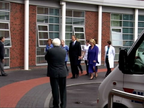 tony blair visits osteoporosis unit; england: west midlands: stourbridge: ext car arriving carrying prime minister tony blair mp and long shot of... - osteoporosis stock videos & royalty-free footage