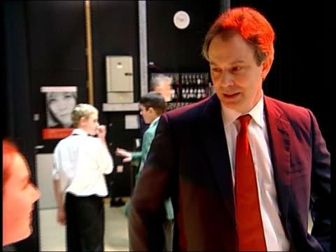 tony blair visits school in enfield; england: london: enfield: int **beware flash photography** tony blair mp talking to two boys / blair walking... - boys beware点の映像素材/bロール