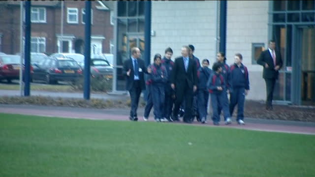 tony blair visits sports complex ext building housing sports hall / blair and children along and into building / blair and others seen inside building - sports hall stock videos & royalty-free footage