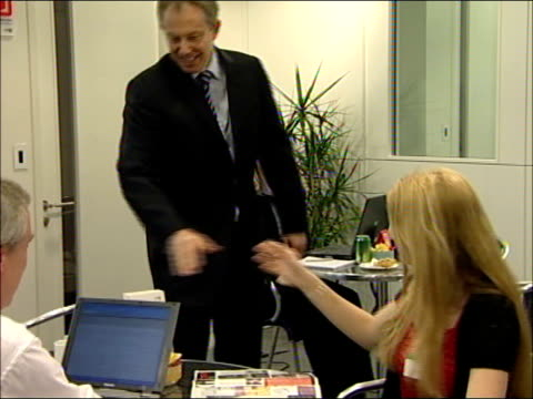 tony blair visits technology firm in the northwest england manchester ext police car arrives followed by blair's car / tony blair mp meets reception... - northwest england stock videos and b-roll footage