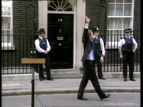 tony blair waves at crowd and holds hands with his wife cherie outside downing street on day he became prime minister 02 may 97 - british labour party stock videos & royalty-free footage