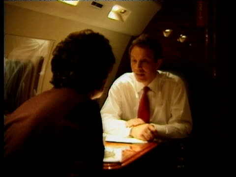 tony blair wife cherie blair and political advisor alastair campbell on board a private jet on the night tony blair's labour party won a landslide... - tony blair stock-videos und b-roll-filmmaterial