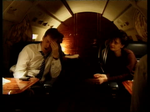 tony blair, wife cherie blair and political advisor alastair campbell on board a private jet on the night tony blair's labour party won a landslide... - anno 1997 video stock e b–roll