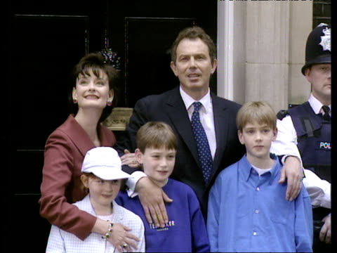tony blair with wife cherie and children kathryn nicholas and euan outside 10 downing street on day he became prime minister 02 may 97 - politik und regierung stock-videos und b-roll-filmmaterial