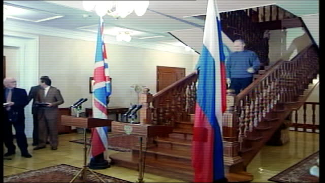tony blair/iraq talks; russia: moscow: dacha: int russian president vladimir putin & tony blair mp sitting at table for photocall blair & putin... - weapons of mass destruction stock videos & royalty-free footage