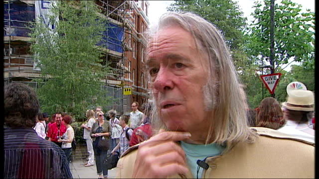 tony bradwell interview sot 129 bus surrounded by crowds as breaks down on zebra crossing man holding copy of abbey road album surrounded by crowds... - rolls royce stock videos & royalty-free footage