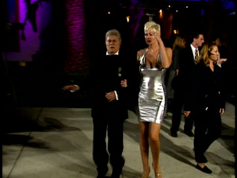 tony curtis and jill vanderberg walk past photographers. - oscar party stock videos & royalty-free footage