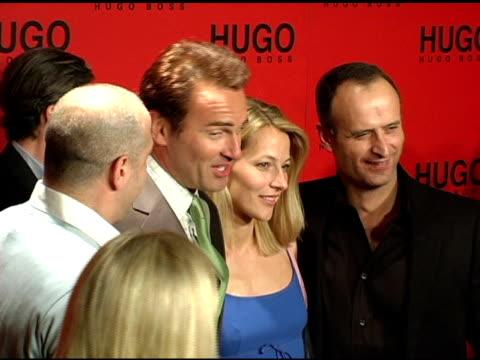stockvideo's en b-roll-footage met tony lucia president/ceo hugo boss usa, julian mcmahon, guest and dr bruno saelzer, chairman of the board at the bash and celebration of hugo boss'... - voorzitter
