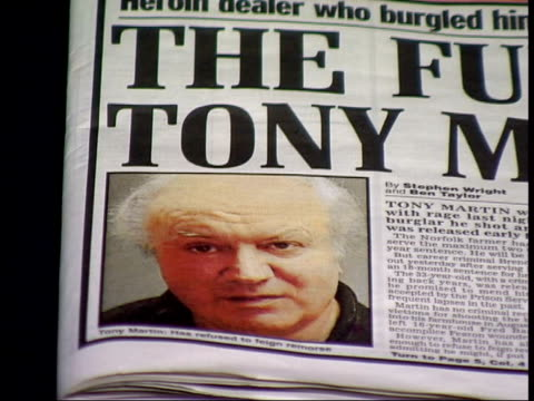 row over release of burgular itn photograph of tony martin on newspaper pull out 'the fury of tony martin' headline in daily mail newspaper as page... - page stock-videos und b-roll-filmmaterial