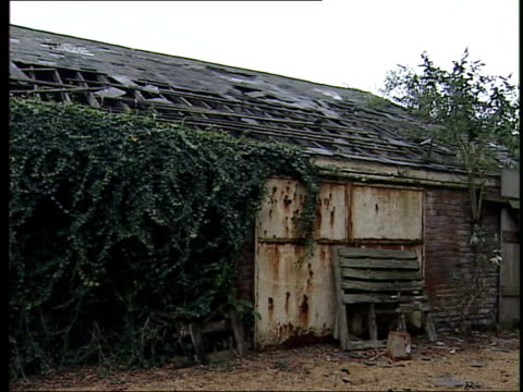 impending release recalls controversy; itn england: norfolk: ext boarded up bleak house farm of tony martin, jailed for shooting dead and wounding 2... - no parking sign stock videos & royalty-free footage