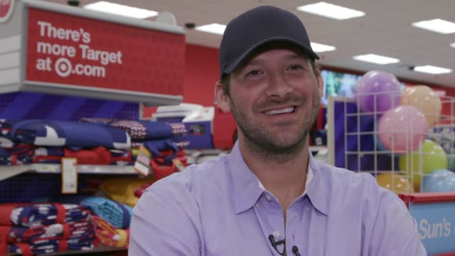 CHYRON Tony Romo Surprises Guests And Helps Them Shop For LastMinute Father's Day Gifts At Dallas Area Target Store on June 15 2016 in Dallas Texas