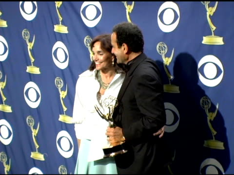 Tony Shalhoub and wife at the 2005 Emmy Awards press room at the Shrine Auditorium in Los Angeles California on September 19 2005