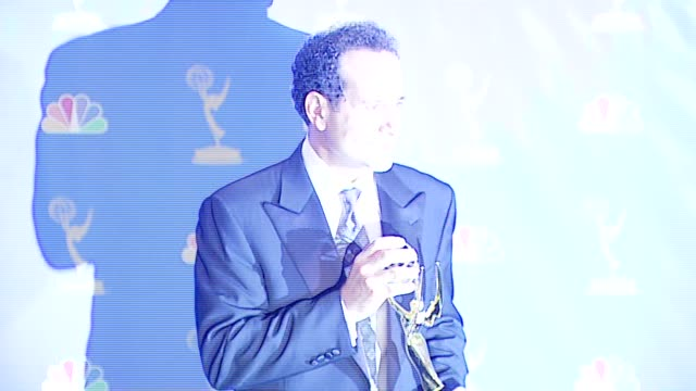 "vídeos de stock, filmes e b-roll de tony shalhoub winner outstanding lead actor in a comedy series for ""monk"" at the 2006 emmy awards press room at the shrine auditorium in los angeles... - shrine auditorium"