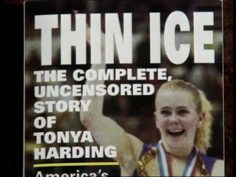 tonya harding admits kerrigan assault plot int cms photo of harding on front cover of paperback with headline thin ice ms paperback on table with... - paperback stock videos & royalty-free footage