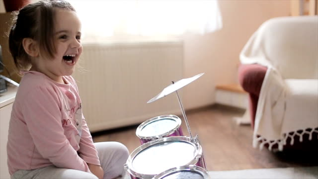 too cute girls playing drums at home - primary age child stock videos and b-roll footage