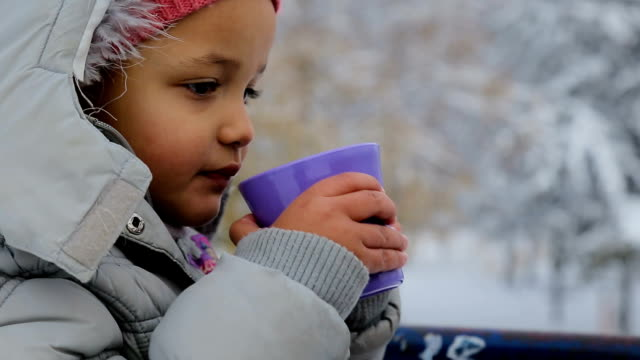 too cute little girl drinking tea on the snow,winter vacations concept - picnic stock videos & royalty-free footage