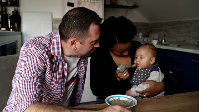 too cute mixed raced baby boy eating - spoon stock videos & royalty-free footage