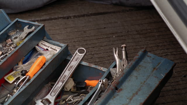 cu toolbox as man reaches for various tools/ new york city - toolbox stock videos and b-roll footage