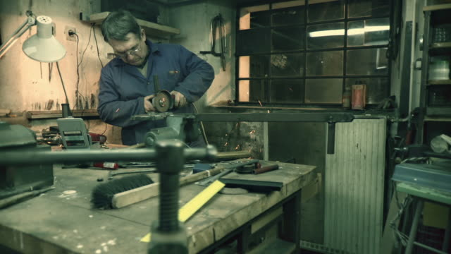 hd dolly: toolmaker cutting metal - metal clip stock videos and b-roll footage