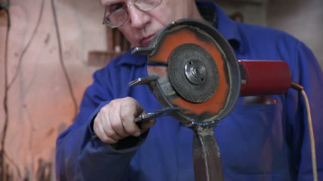 hd dolly: toolmaker measuring the object - vernier calliper stock videos & royalty-free footage