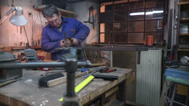 HD DOLLY: Toolmaker Working With Circular Saw