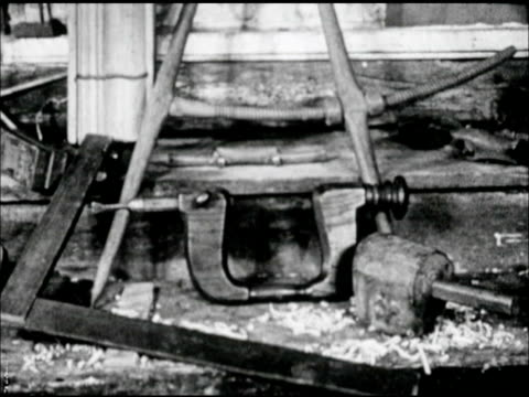 tools grouped in barn next to wood shavings, straight edge, wooden compass, clamp. carved wooden ladle next to bucket. handmade wooden tankard &... - clamp stock videos & royalty-free footage