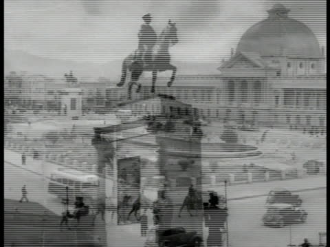 toopkhaneh square w/ large building pool camels and cars on road statue of riza shah busy maidan w/ traffic around fountain modern building - teheran stock-videos und b-roll-filmmaterial
