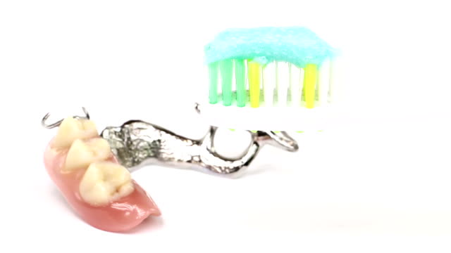 toothbrush and false teeth - dentures stock videos and b-roll footage