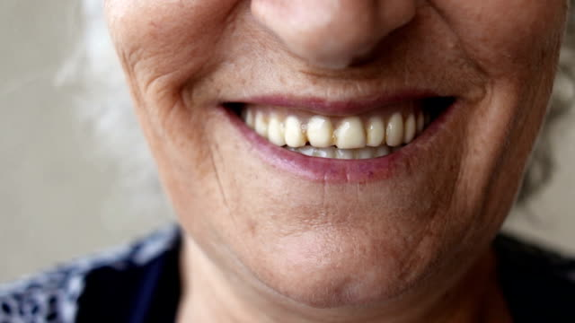 Toothy smile of a senior woman