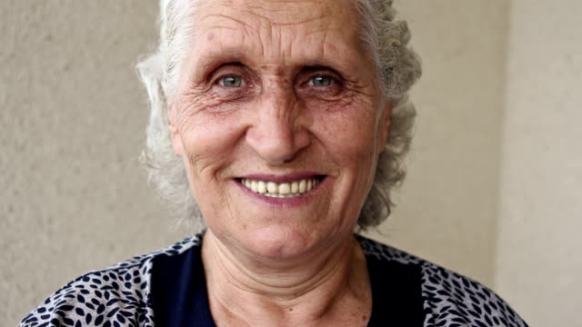 zoom in: toothy smile of a senior woman - turkey stock videos and b-roll footage