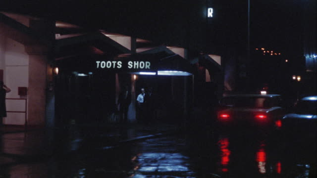 1969 WS Toots Shor restaurant illuminated at night, New York City, New York, USA