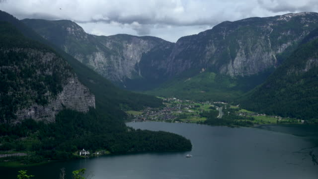 top aerial view of hallstatt village and lake, austria - traditionally austrian stock videos & royalty-free footage