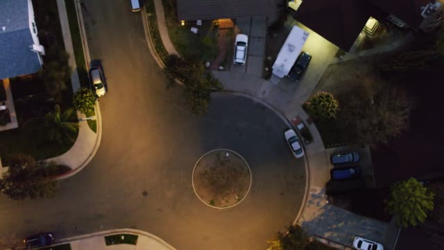 top down aerial of suburban homes at night - district stock videos & royalty-free footage