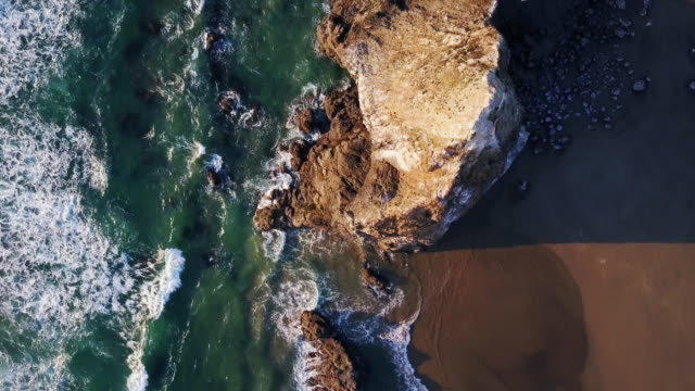 top down aerial view of dramatic oregon coastline - rock formation stock videos & royalty-free footage