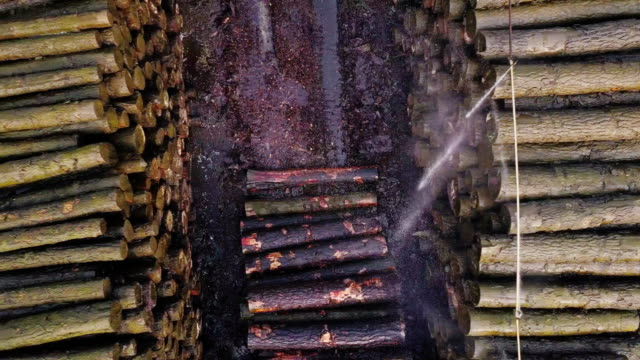 top down aerial view of lumber yard - lumberyard stock videos and b-roll footage