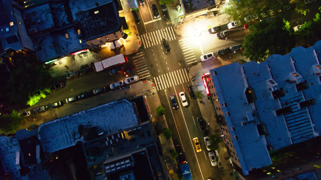 top down drone flight over nostrand avenue at night - urban road stock videos & royalty-free footage
