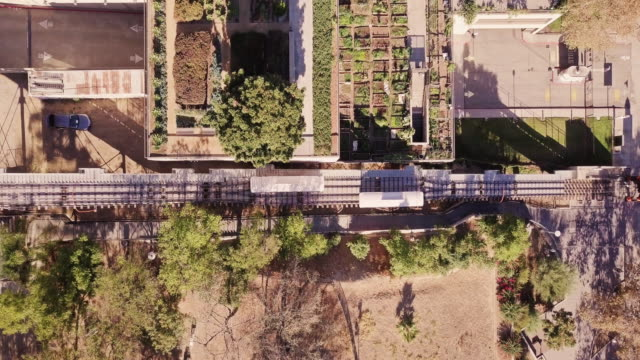 top down drone shot of angels flight funicular railway, los angeles - tram stock-videos und b-roll-filmmaterial