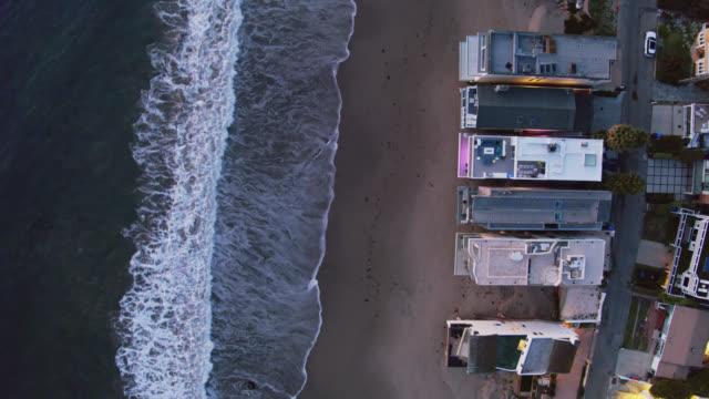 top down drone shot of beachfront houses in malibu - malibu stock videos & royalty-free footage