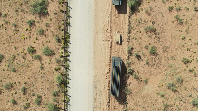 top down drone shot of construction materials at us-mexico border - texas stock videos & royalty-free footage