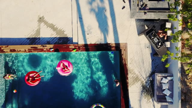 Top Down Drone Shot of DJ Playing at Pool Party
