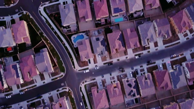 top down drone shot of growing suburb - housing difficulties stock videos & royalty-free footage