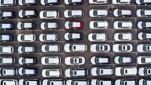top down drone shot of new cars in yard - conformity stock videos & royalty-free footage