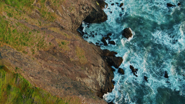 top down drone shot of the oregon coast looking down on churning waves - oregon coast stock videos & royalty-free footage