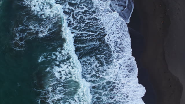 Top Down Drone Shot of Waves Crashing on Beach