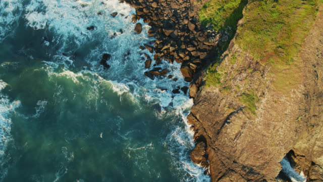 top down drone shot of waves crashing on oregon coast - oregon coast stock videos & royalty-free footage